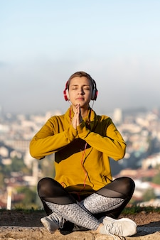 Full shot of woman meditating