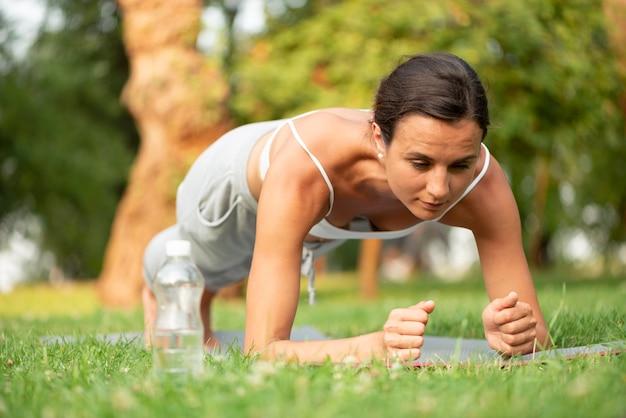 Full shot woman plank workout