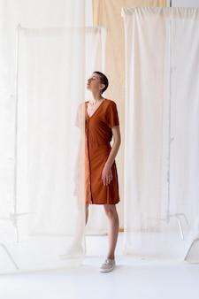 Full shot woman posing in studio