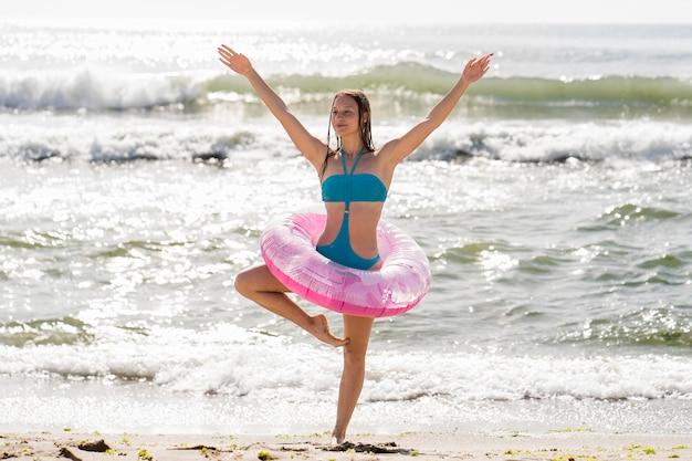 Full shot woman posing with pink lifeline