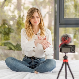 Full shot woman recording herself