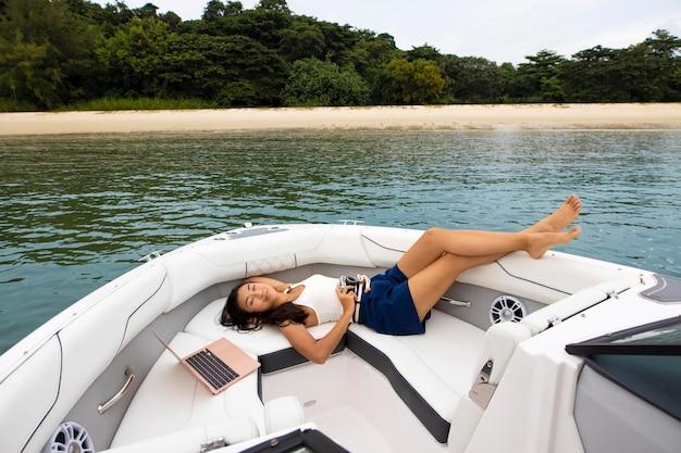 Full shot woman relaxing on boat