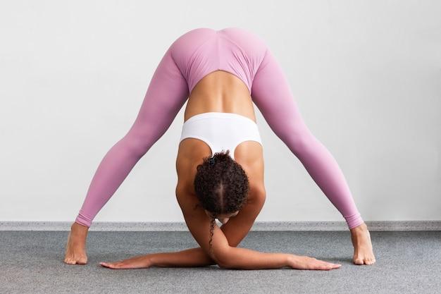 Full shot woman showing flexibility