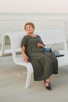 Full shot woman sitting on bench