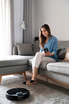 Full shot woman sitting on couch