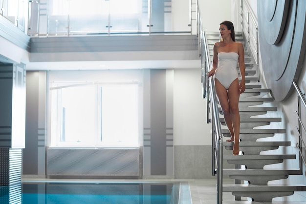 Full shot woman on stairs