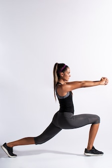 Full shot woman stretching with copy-space