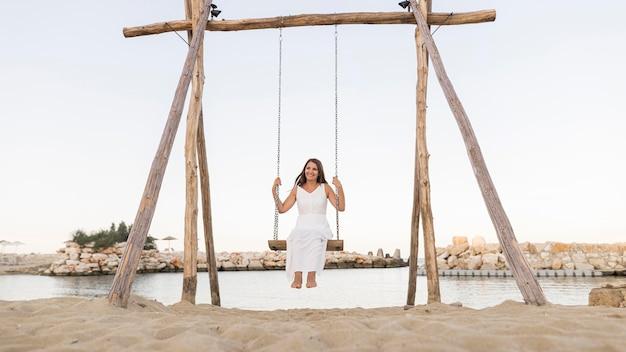 Full shot woman in swing