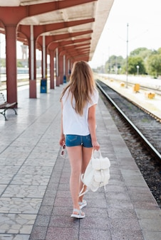 Full shot woman in train station