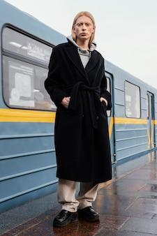 Full shot woman at train station