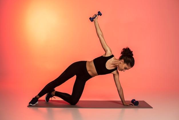 Full shot woman training abs