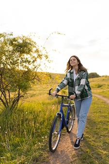 Full shot woman with bicycle