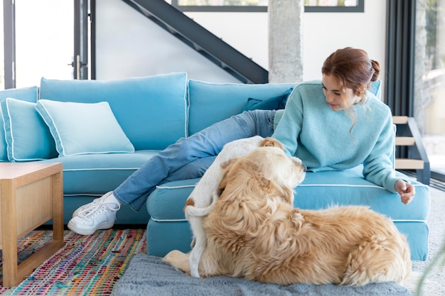 Full shot woman with cute dog indoors