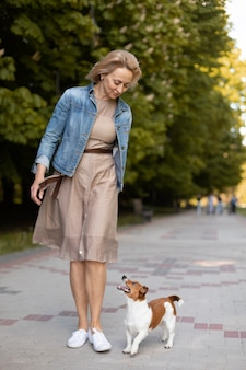 Full shot woman with cute dog