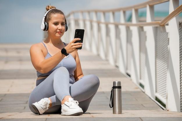 Full shot woman with headphones