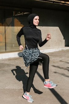 Full shot of woman with hijab training