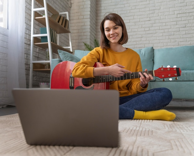 Full shot woman with laptop