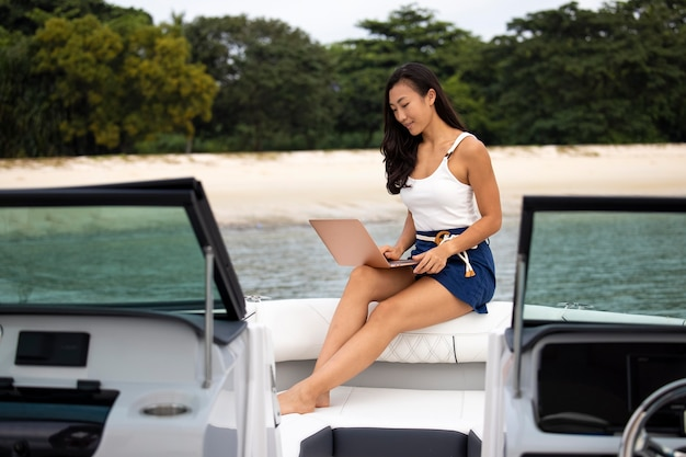 Full shot woman working on boat