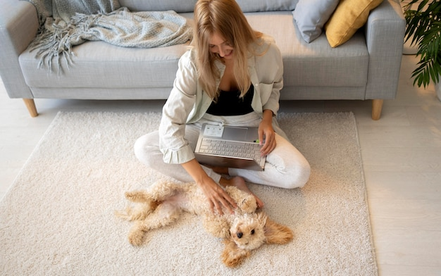Full shot woman working on laptop indoors