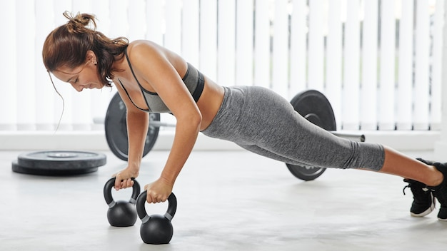 Full shot woman working out with dumbbells