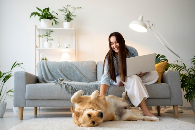 Full shot woman working with cute dog