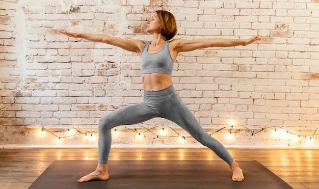 Full shot woman yoga pose