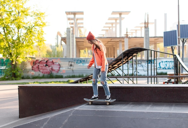 Full shot young girl on skate outside