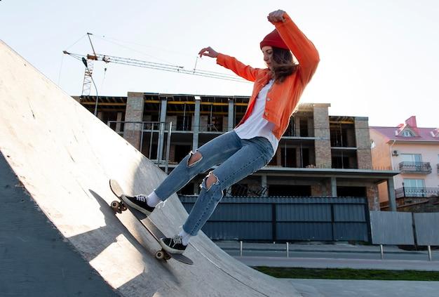 Full shot young girl on skateboard