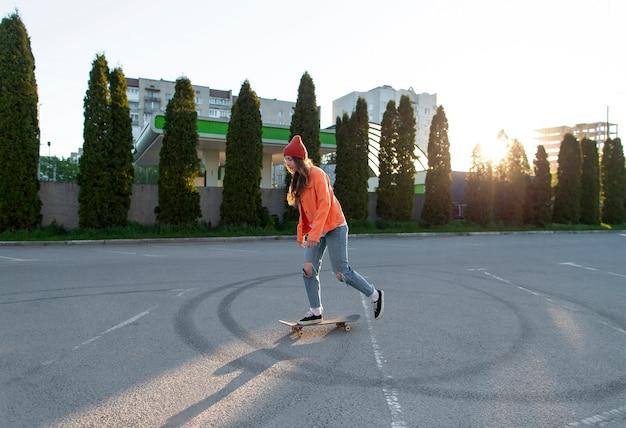 Full shot young girl skating outdoors
