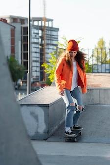 Full shot young girl skating