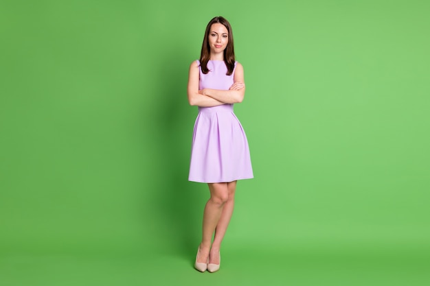 Full size photo of beautiful serious independent woman lady stand folded hands look camera provoke action manage workers strict wear purple dress isolated pastel green color background