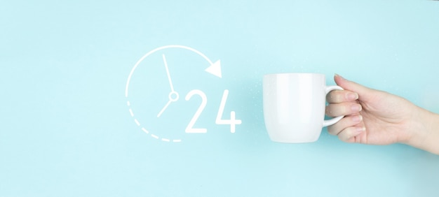 Full time service concept. girl hand hold morning coffee cup with sign 24 7 all day all night icon on blue background.