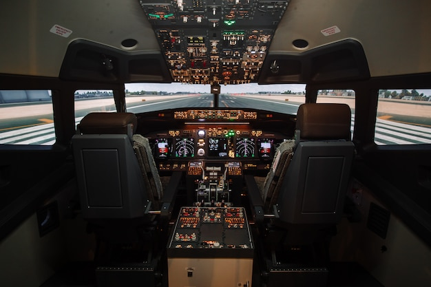 Full view of cockpit modern boeing aircraft before take-off.