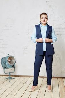 Full woman, confident successful woman posing in the interior design studio. fat woman plus size with no complexes. russia, sverdlovsk, february 27, 2018