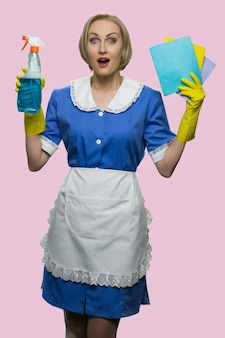 Fullsized portrait of surprised blonde housekeeper