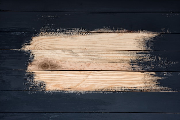 Not fully painted wooden boards in black. place for text. work in progress