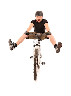 Fun bicyclist isolated on white, studio shot.