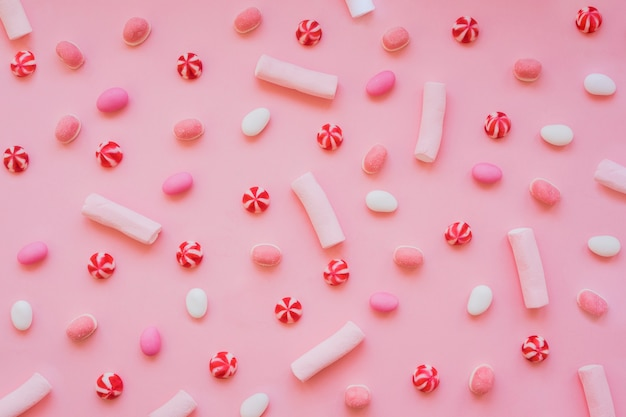 Fun composition with marshmallows, candies and sweets