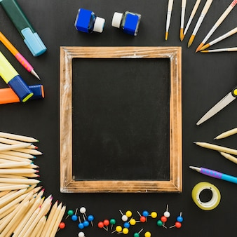 Fun composition with school materials and wooden frame
