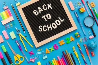 Fun composition with school supplies and wooden frame