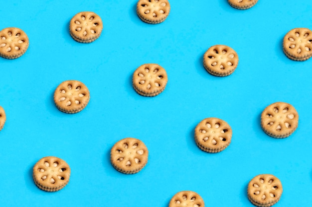 Fun cookies, biscuits, snacks peanut butter in soft blue flat background