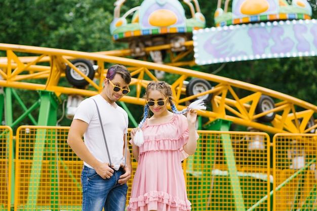 Fun funny and funny couple in love a guy and a girl in sunglasses are smiling and happy