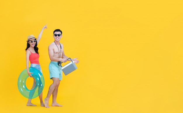 Fun happy asian couple in casual summer beach outfits with accesseries