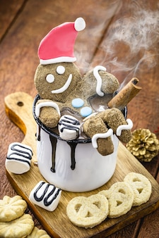 Fun homemade christmas cookie with steaming hot chocolate, background for happy christmas