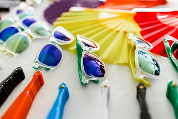 Fun set of fans and sunglasses of many colors for parties in summer.