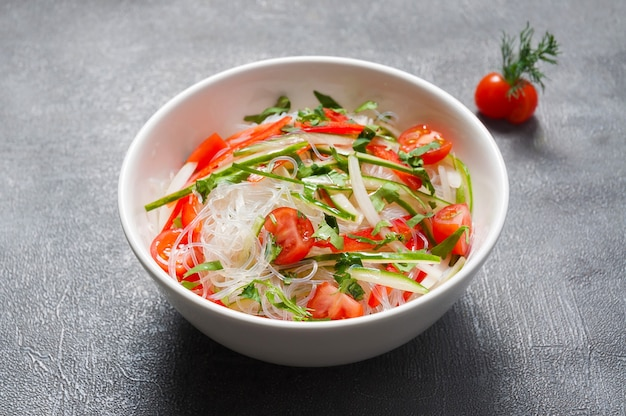 Funchosa with cucumbers, tomatoes and pepper. japanese cuisine