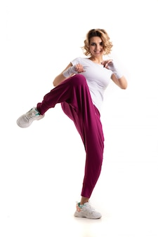 Funk dance workout. portrait of young sporty woman in motion