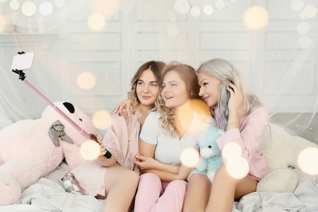 Funny adult women having a slumber party.
