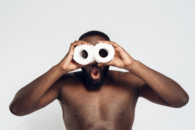 Funny african american man looks through rolls.