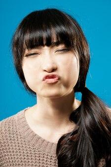 Funny asian beauty, closeup portrait